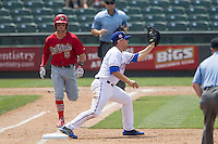 Memphis Redbirds shortstop Greg Garcia #5 runs to first base as Round Rock Express first baseman Brett Nicholas #19 records a out during the Pacific Coast League baseball game on April 27, 2014 at the Dell Diamond in Round Rock, Texas. The Express defeated the Redbirds 6-2. (Andrew Woolley/Four Seam Images)