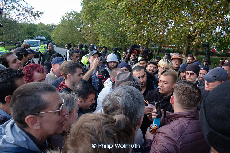 Tan, with other Tommy Robinson supporters before being removed by police from Speakers' Corner, Hyde Park, London.