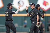 Vanderbilt Commodores outfielder JJ Bleday (51) celebrates with teammate Julian Infante (22) after winning Game 8 of the NCAA College World Series against the Mississippi State Bulldogs on June 19, 2019 at TD Ameritrade Park in Omaha, Nebraska. Vanderbilt defeated Mississippi State 6-3. (Andrew Woolley/Four Seam Images)