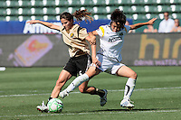 Aya Miyama #8 of the Los Angeles Sol battles Tiffeny Milbrett #15 of  FC Gold Pride for a loose ball during their WPS game at The Home Depot Center on June 21,2009 in Carson, California.  The Sol defeated the Pride 2-0.