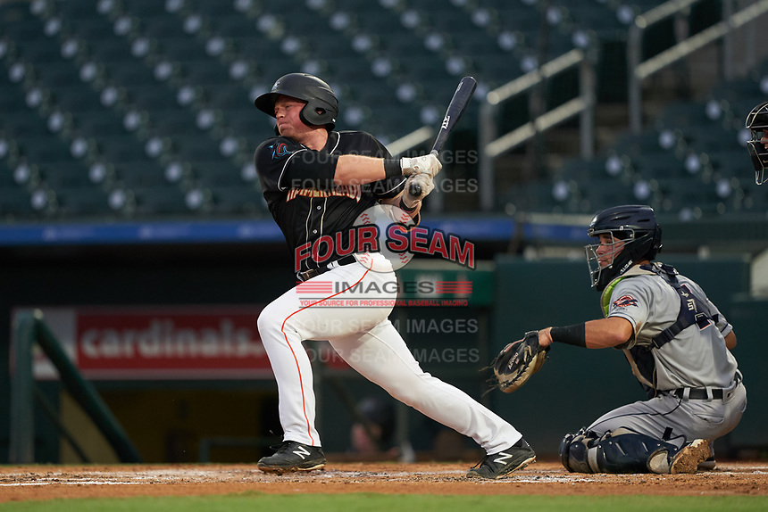 Jupiter Hammerheads Gunnar Schubert (12) at bat in front of catcher Brady Policelli (7) during a Florida State League game against the Lakeland Flying Tigers on August 12, 2019 at Roger Dean Chevrolet Stadium in Jupiter, Florida.  Jupiter defeated Lakeland 9-3.  (Mike Janes/Four Seam Images)