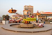 Tripoli, Libya, North Africa - Libyan Children on Amusement Park Ride.