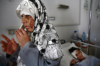 Tyr, Lebanon, July 21 2006.Amena, 34, with her son Hussein Shelhoub, 13, were wounded when their house collapsed as a result of an israeli air strike on their village. A piece of shrapnel went straight through Hussein's brain, he also suffered from severe abdominal bleeding, his mother suffers from face and body trauma.