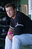 Zach Fish (24) of the Kannapolis Intimidators sits in the dugout during the game against the Lakewood BlueClaws at Kannapolis Intimidators Stadium on May 8, 2016 in Kannapolis, North Carolina.  The Intimidators defeated the BlueClaws 3-2.  (Brian Westerholt/Four Seam Images)
