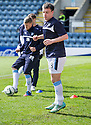 Dundee's Paul McGowan tag clearly visible beneath his sock as he warms up before the game.
