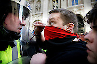 A demonstrator shouts in the face of a police officer as thousands of protestors descended on the City of London ahead of the G20 summit of world leaders to express anger at the economic crisis, which many blame on the excesses of capitalism.