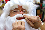 WATERBURY CT. 22 December 2017-122217SV03-Mike Patrick, Republican American, sees what it feels like to transform into Santa at Arabesque on Bank Street in Waterbury Friday. Michael Rinaldi, owner dressed Mike.<br /> Steven Valenti Republican-American