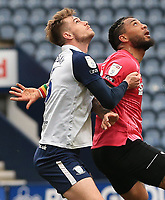 20th April 2021; Deepdale, Preston, Lancashire, England; English Football League Championship Football, Preston North End versus Derby County; Liam Lindsay of Preston North End challenges Colin Kazim-Richards of Derby County for a header