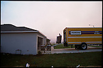May 27, 2001. In Groveland, Near Orlando, Florida a new home owner moves in. Sprawling suburban communities are now in burn areas. Residents must cope with living in former swamps and wildlife areas.