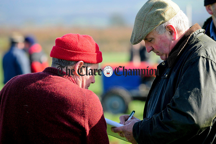 Johnnie White,Meelick and Noel Fitzgerald, County Secretary during the ploughing match at O'Callaghans Mills.pic Arthur Ellis.