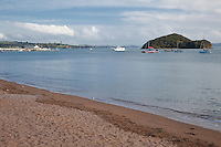 Paihia Bay, Ferry from Russell Arriving, Waitangi Treaty Grounds in distance.  Paihia, north island, New Zealand.