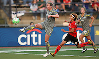 Philadelphia defender, Sara Larsson (7) clears the ball away from Atlanta attacker, Mami Yamaguchi (9), as Nikki Krzysik (15) looks on.  Atlanta and Philadelphia played to a 0-0 draw in the season opener for both teams at John A Farrell Stadium in West Chester, PA.