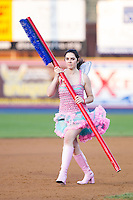 "The ""Tooth Fairy"" cleans the bases between innings of the Eastern League game between the Akron Rubber Ducks and the Reading Fightin Phils at FirstEnergy Stadium on June 19, 2014 in Reading, Pennsylvania.  The Rubber Ducks defeated the Fightin Phils 3-2.  (Brian Westerholt/Four Seam Images)"