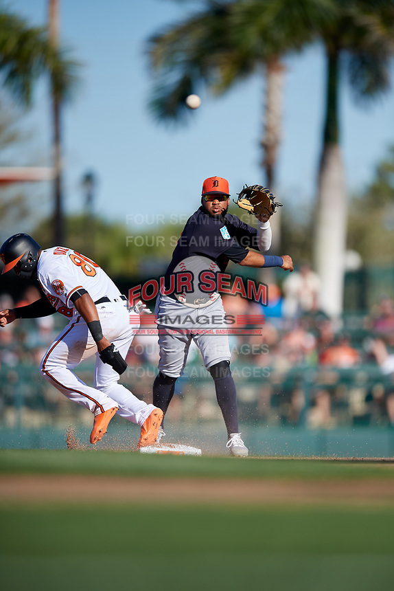 Detroit Tigers second baseman Dawel Lugo (18) throws to first base after forcing out Yusniel Diaz (80) during a Grapefruit League Spring Training game against the Baltimore Orioles on March 3, 2019 at Ed Smith Stadium in Sarasota, Florida.  Baltimore defeated Detroit 7-5.  (Mike Janes/Four Seam Images)