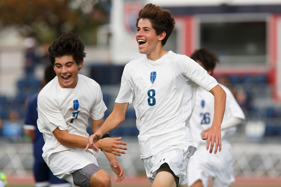 Mishawaka Marian's Johnathan Tavarez (8) celebrates after scoring a goal against Providence during the IHSAA Class A Boys Soccer State Championship Game on Saturday, Oct. 29, 2016, at Carroll Stadium in Indianapolis. Marian won 4-0. Special to the Tribune/JAMES BROSHER