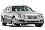 Low aggressive passenger side front three quarter view of 2009 Mercedes E Class Wagen 350 Stock Photo