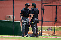 Umpires Jaylen Goodmans (left) and Chad Westlake (right) during a Gulf Coast League game between the GCL Tigers West and GCL Phillies West on July 27, 2019 at the Carpenter Complex in Clearwater, Florida.  (Mike Janes/Four Seam Images)