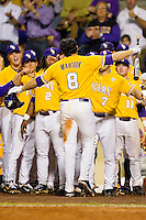 Mikie Mahtook #8 of the LSU Tigers is greeted by teammates after hitting a home run against the Wake Forest Demon Deacons at Alex Box Stadium on February 18, 2011 in Baton Rouge, Louisiana.  The Tigers defeated the Demon Deacons 15-4.  Photo by Brian Westerholt / Four Seam Images