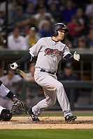 Cody Asche (12) of the Scranton/Wilkes-Barre RailRiders follows through on his swing against the Charlotte Knights at BB&T BallPark on April 12, 2018 in Charlotte, North Carolina.  The RailRiders defeated the Knights 11-1.  (Brian Westerholt/Four Seam Images)
