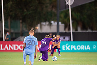LAKE BUENA VISTA, FL - JULY 14: Dom Dwyer #14 of Orlando City SC kneeling before the game during a game between Orlando City SC and New York City FC at Wide World of Sports on July 14, 2020 in Lake Buena Vista, Florida.