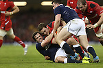 Scotland centre Alex Dunbar hauls down Wales wing George North.<br /> RBS 6 Nations 2014<br /> Wales v Scotland<br /> Millennium Stadium<br /> <br /> 15.03.14<br /> <br /> ©Steve Pope-SPORTINGWALES