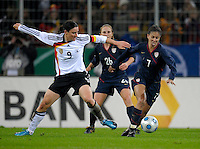 Shannon Boxx (7) dribbles the ball against Birgit Prinz (9). US Women's National Team defeated Germany 1-0 at Impuls Arena in Augsburg, Germany on October 27, 2009.