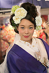 A model wearing traditional kimono poses for a picture during the Moshi Moshi Nippon Festival 2016 on November 26, 2016 in Tokyo, Japan. Moshi Moshi Nippon Festival 2016 aims to promote Japanese pop culture (fashion, anime, technology, music and food) to the world, and non-Japanese visitors are able to enter the event for free by showing their passport. This year's two day event included live shows by Japanese pop stars Silent Siren, Dempagumi.inc, Tempura Kids, Capsule and Kyary Pamyu Pamyu at the Tokyo Metropolitan Gymnasium. (Photo by Rodrigo Reyes Marin/AFLO)