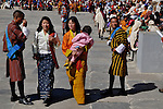 """Young bhutanese ladies in their national dress at Thimpu Tshechu. The Tshechu is a festival honouring Guru Padmasambhava, """"one who was born from a lotus flower."""" This Indian saint contributed enormously to the diffusion of Tantric Buddhism in the Himalayan regions of Tibet, Nepal, Bhutan etc. around 800 AD. He is the founder of the Nyingmapa, the """"old school"""" of Lamaism which still has numerous followers. The biography of Guru is highlighted by 12 episodes of the model of the Buddha Shakyamuni's life. Each episode is commemorated around the year on the 10th day of the month by """"the Tschechu"""". The dates and the duration of the festivals vary from one district to another but they always take place on or around the 10th day of the month according to the Bhutanese calendar. During Tshechus, the dances are performed by monks as well as by laymen. The Tshechu is a religious festival and by attending it, it is believed one gains merits. It is also a yearly social gathering where the people, dressed in all their finery, come together to rejoice. Arindam Mukherjee."""