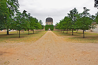 Chateau de Sales with cupola like building, view along the tree lined road allee Pomerol Bordeaux Gironde Aquitaine France