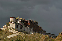 A big rainstorm approching the Potala in the late afternoon, with a rainbow appearing..Little remains of the original Potala Palace of the seventh century, built as a place for meditation by King Songtsen Gampo on the occasion of his marriage to Princess Wencheng of the Tang Court. Standing atop the Red Hill in Lhasa, the current structure dates from the 17th century; it was rebuilt by the 5th Dalai Lama and became the Winter Palace of the Dalai Lamas from that time. The 13-story building of 1,000 rooms can be seen from many miles away...The Potala is divided into two sections--an outer section, the White Palace, and an inner section, the Red Palace, the latter containing the temples and reliquary tombs of the Dalai Lamas. The entire building is a structure of stone and timber. At a height of 117 meters, the Potala was the world's tallest building until 20th-century architects designed cityscapes of new buildings that far surpassed the Potala in height--but not in its architectural majesty..