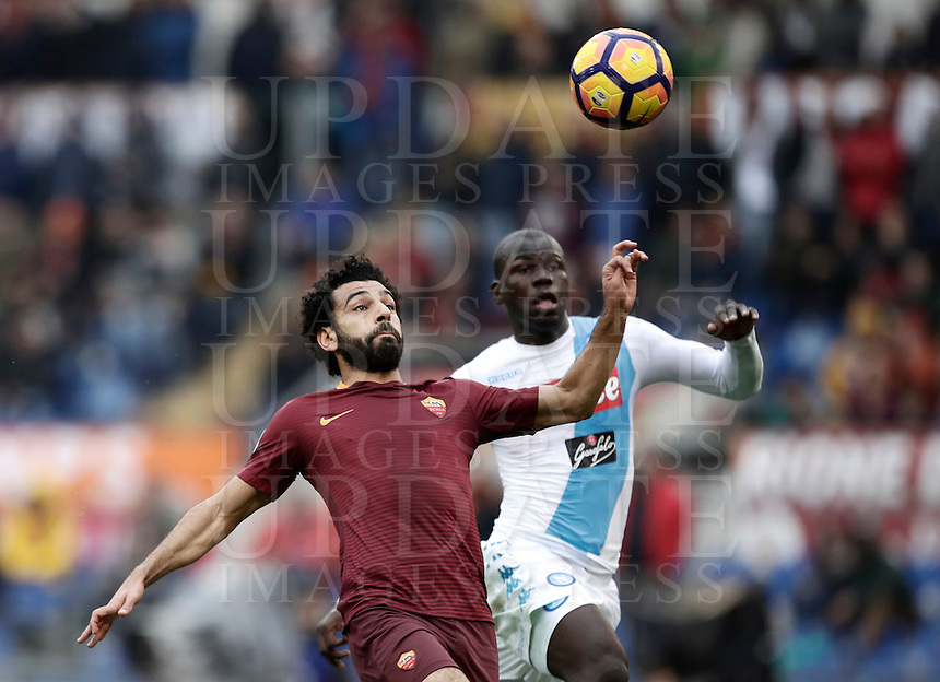 Roma's Mohamed Salah, left, is chased by Napoli's Kalidou Koulibaly during the Serie A soccer match between Roma and Napoli at the Olympic stadium, 4 March 2017.<br /> UPDATE IMAGES PRESS/Isabella Bonotto