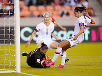 HOUSTON, TX - FEBRUARY 03: Priscilla Tapia #18 GK of Costa Rica saves a ball from Carli Loyd #10 of the United States during a game between Costa Rica and USWNT at BBVA Stadium on February 03, 2020 in Houston, Texas.