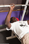 Education High School physical education elective weight lifting teenager on back using equipment