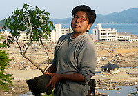 Mitsuyuki Sasaki, 49, stands with his only posession a wisteria plant in Minamisanriku, Myiagi, Japan. The fishing port of Minamisanriku, Miyagi, Japan was devastated by the tsunami where the popultion was reduced from 18,000 to about 8,000.<br /> <br /> Richard Jones / Sinopix