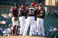 Rochester Red Wings manager Mike Quade (8) makes a pitching change flanked by Eric Fryer, Reynaldo Rodriguez (23) and James Beresford during a game against the Norfolk Tides on May 3, 2015 at Frontier Field in Rochester, New York.  Rochester defeated Norfolk 7-3.  (Mike Janes/Four Seam Images)
