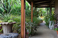 Covered walkway between house and garden with container plantings,  Sherry Merciari garden