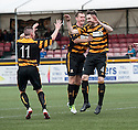 Alloa's Ben Gordon (4) celebrates with Stephen Simmons (6) and Declan McManus (11) after he scores their first goal.