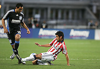 Paulo Nagamura (5) slides against Arturo Alvarez (10). Chivas USA defeated San Jose Earthquakes 1-0 at Buck Shaw Stadium in Santa Clara, California on May 2, 2009.