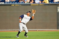 Second baseman Eduardo Escobar #3 of the Charlotte Knights catches a fly ball in shallow right field against the Durham Bulls at Durham Bulls Athletic Park on August 28, 2011 in Durham, North Carolina.   (Brian Westerholt / Four Seam Images)