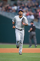 Louisville Bats right fielder Yorman Rodriguez (20) jogs off the field between innings of the International League game against the Charlotte Knights at BB&T BallPark on May 12, 2015 in Charlotte, North Carolina.  The Knights defeated the Bats 4-0.  (Brian Westerholt/Four Seam Images)