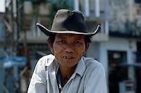 Mann mit Hut in Saigon, Vietnam
