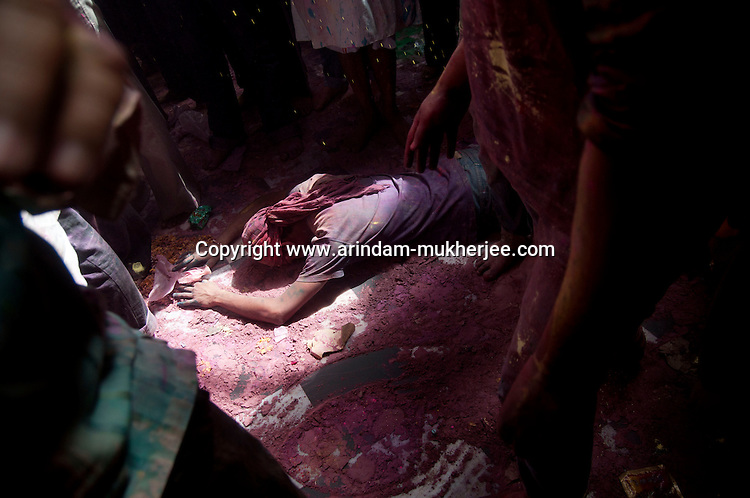 A man lying down on the ground and showing respect to Hindu god Krishna at Banke Bihari temple in Vrindavan, 8th March 2012. Uttar Pradesh, India