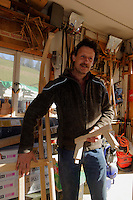 Rodelbauer Dietmar Martin mit Hörnerschlitten in Sonthofen-Tiefenbach im Allgäu, Bayern, Deutschland<br /> sledge maker Dietmar Martin with horned sledge  in Sonthofen-Tiefenbach , Allgäu, Bavaria, Germany
