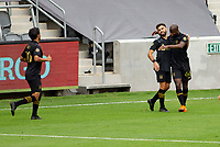 LOS ANGELES, CA - OCTOBER 25: Carlos Vela #10, Bradley Wright-Phillips #66 and Diego Rossi #9 celebrate a LAFC goal during a game between Los Angeles Galaxy and Los Angeles FC at Banc of California Stadium on October 25, 2020 in Los Angeles, California.