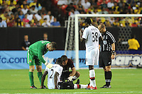 Goalkeeper Shay Given and the Manchester City trainer check on defender Micah Richards. The 2010 Atlanta International Soccer Challenge was held, Wednesday, July 28, at the Georgia Dome, featuring a match between Club America and Manchester City. After regulation time ended 1-1, Manchester City was awarded the victory, winning 4-1, in penalty kicks.