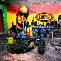 A pile of lighting equipment is scattered in front of a mural at the studios of Power House a Luanda based production company who are a major force in the making of Kuduru/Kuduro music videos.