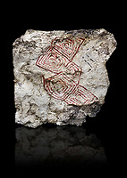 Geometric wall painting fragment found in 1999 in building 2, space 117, level IX. Unit no 4223X1. Catalhoyuk collection, Konya Archaeological Museum, Turkey. Against a black background
