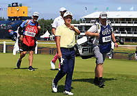 15th July 2021; Royal St Georges Golf Club, Sandwich, Kent, England; The Open Championship, PGA Tour, European Tour Golf, First Round ; Takumi Kanaya (JAP) smiles and crosses his fingers as he walks from the tee of the opening hole