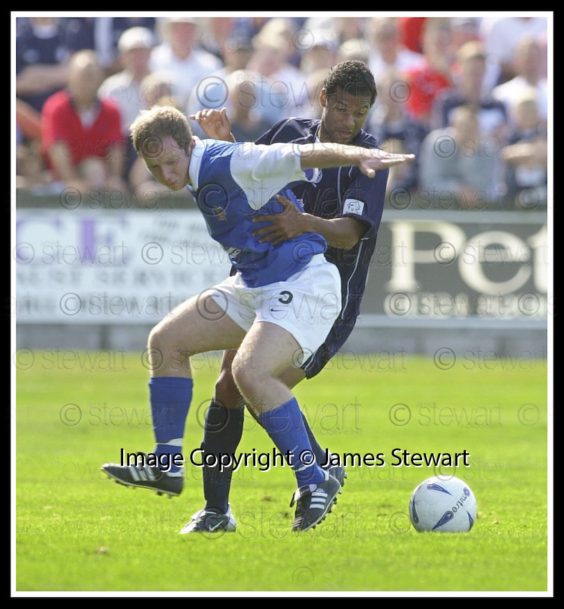23/08/2003                   Copyright Pic : James Stewart.File Name : stewart-falkirk v qots 06.GARY WOOD HOLDS OFF BRENT RAHIM......James Stewart Photo Agency, 19 Carronlea Drive, Falkirk. FK2 8DN      Vat Reg No. 607 6932 25.Office     : +44 (0)1324 570906     .Mobile  : +44 (0)7721 416997.Fax         :  +44 (0)1324 570906.E-mail  :  jim@jspa.co.uk.If you require further information then contact Jim Stewart on any of the numbers above.........