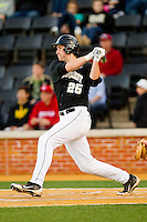 Matt Conway (25) of the Wake Forest Demon Deacons follows through on his swing against the North Carolina Tar Heels at Wake Forest Baseball Park on March 9, 2013 in Winston-Salem, North Carolina.  The Tar Heels defeated the Demon Deacons 20-6.  (Brian Westerholt/Four Seam Images)
